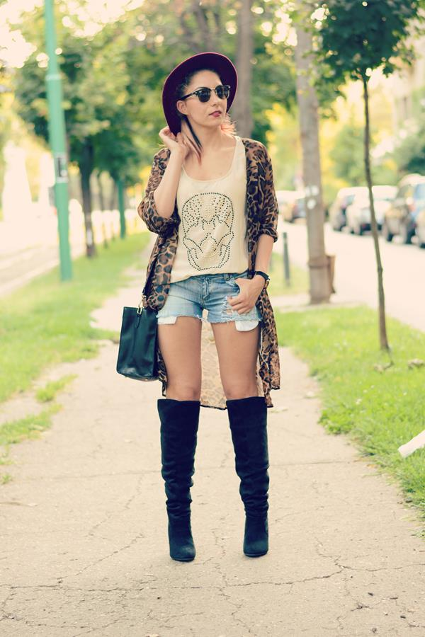 knee high boots ripped shorts