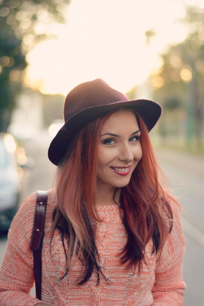 orange top burgundy hat