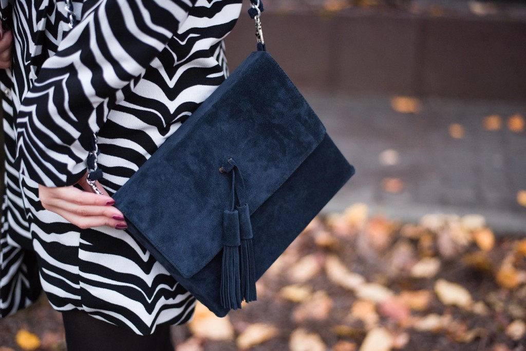 wearing zebra print and suede bag