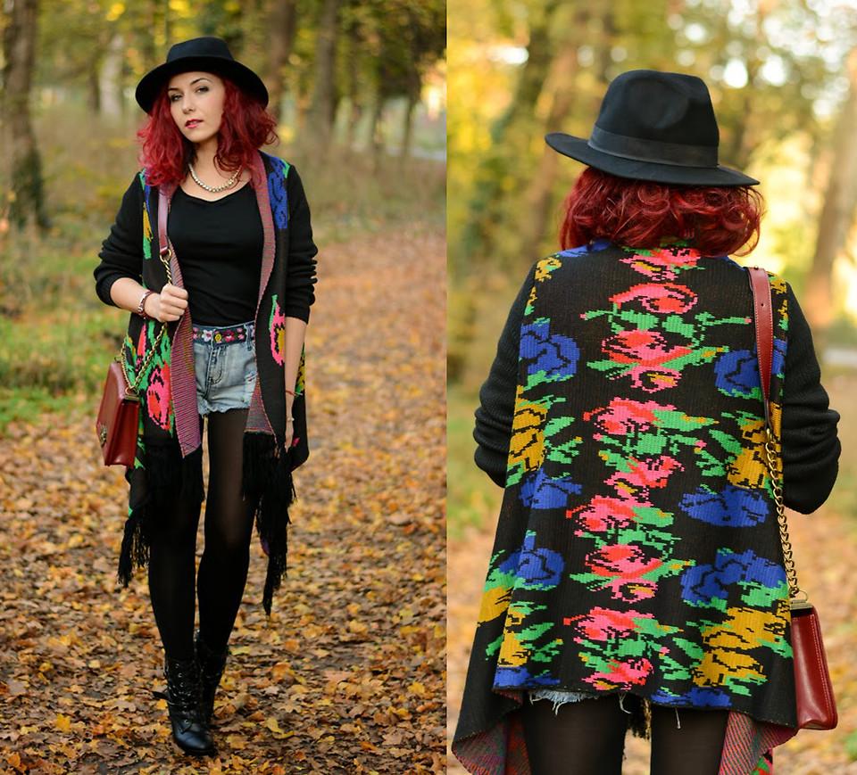 wearing a black fedora in autumn